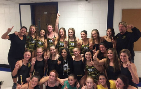 The Girls Swim Team Races To Victory