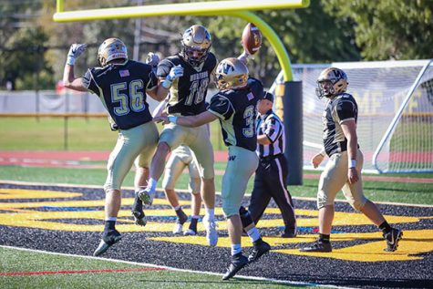Football Team Blitzes Conference III
