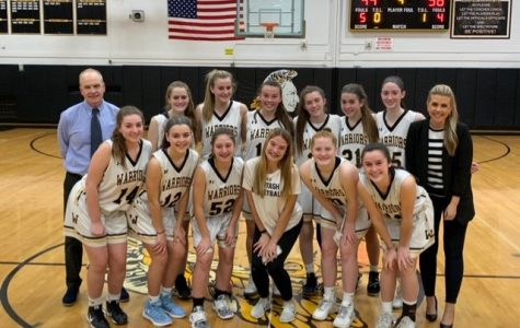 Coach B and Coach Colton and this year's girls' varsity basketball team