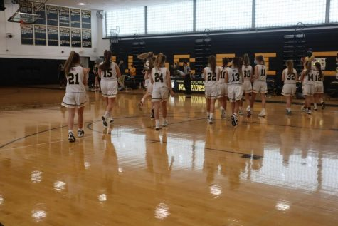 Wantagh Girls Basketball team walks off the court after National Anthem.
